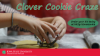 Child cutting dough with a cookie cutter